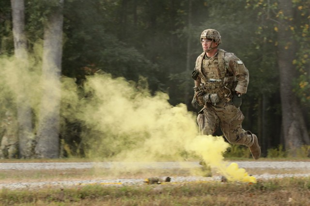 Staff Sgt. Dakota Bowen, the Army's NCO of the Year, reacts to contact during the 2019 Best Warrior Competition at Fort A.P. Hill, Va., Oct. 10, 2019. The Best Warrior Competition represents highly trained, disciplined and physically fit Soldiers from cohesive teams across the Army capable of winning on any battlefield.