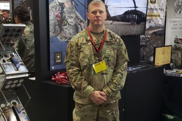 Lt. Col. Justin Avery  at the 2019 AUSA Annual Meeting and Exposition U.S. Army booth.