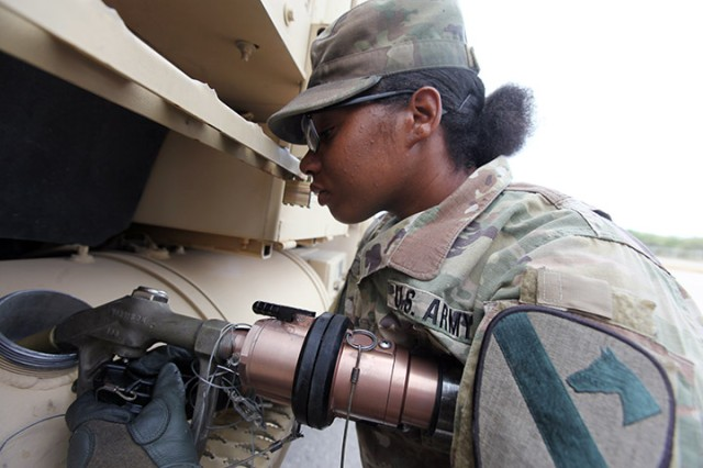 Pfc. Airieal Perry, 154th Transportation Company motor transport operator, and fueler, refuels a Heavy Equipment Transporter Systems Oct. 14, 2019, at Fort Sill. She put 154 gallons of JP-8 into the HETS.
