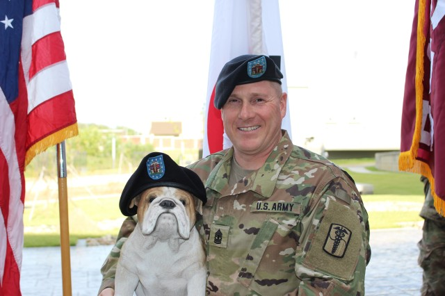 1st Sgt. Dilday posed with the unit's mascot, bulldog before the ceremony.