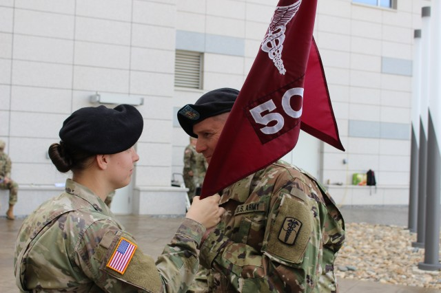 Capt. Dirks passes the company guidon to 1st Sgt. Dilday