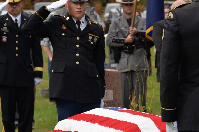 New York Army National Guard Spc. Ryan Gosse, center, and Army Brig. Gen. Brett Funck, Deputy Commanding General of the 10th Mountain Division, render graveside honors during the funeral of Army Medal of Honor recipient Tech. Sgt. Francis S. Currey at the Mt. Pleasant Cemetery in South Bethlehem, N.Y., October 12, 2019. Currey, 94, from Selkirk, N.Y., died October 8. He received the Medal of Honor for valor displayed as an infantryman during the Battle of the Bulge in World War II. Members of the New York Military Forces Honor Guard provided military honors for the funeral service.