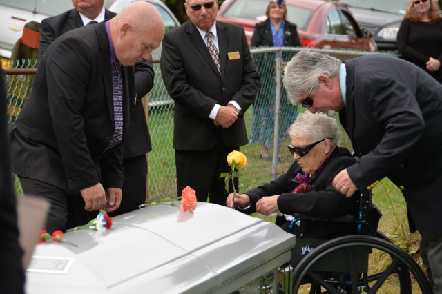 Wilma Currey, with family members, places flowers on the casket of her husband, Medal of Honor recipient Sgt. Francis S. Currey at the Mt. Pleasant Cemetery in South Bethlehem, N.Y., October 12, 2019. Currey, 94, from Selkirk, N.Y., died October 8. He received the Medal of Honor for valor displayed as an infantryman during the Battle of the Bulge in World War II. Members of the New York Military Forces Honor Guard provided military honors for the funeral service.