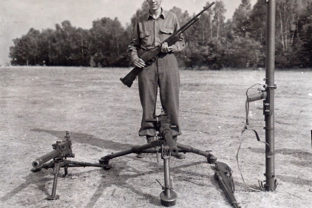 Technical Sgt. Francis S. Currey, Company K, 120th Infantry Regiment, 30th Infantry Division, poses July 26, 1945, with the weapons he used while halting a German attack on his company Dec. 21,1944, during the Battle of the Bulge. Maj. Gen. Leland S. Hobbs, commanding general, 30th Infantry Division, presented him with the nation's highest award, the Medal of Honor, near Reims, France.