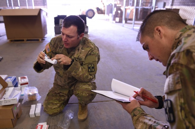 Army Soldiers inventory new medical materiel in the field.