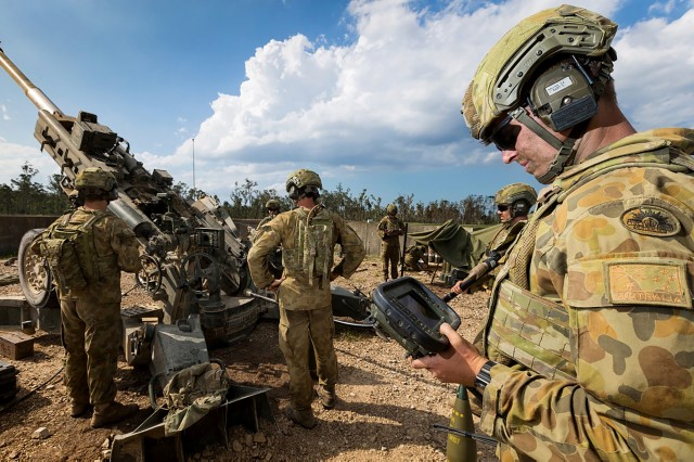 A lance bombardier with the Australian Army readies an M777 howitzer for a fire mission during an exercise in 2017. Extending the range and accuracy of the M777 is an important component of U.S. Army efforts to modernize long-range precision fires and enhance joint multidomain operations. (Photo by Cpl. David Said, ADF)