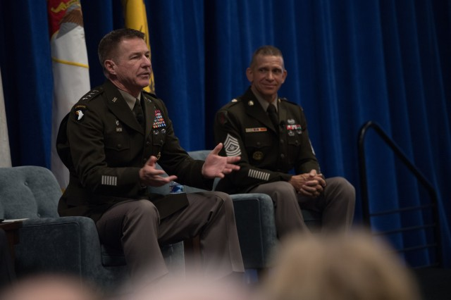 Gen. James McConville, chief of staff of the Army, speaks during a family forum as Sgt. Maj. of the Army Michael Grinston watches on during the Association of the U.S. Army Annual Meeting and Exposition in Washington, D.C., Oct. 15, 2019.