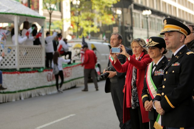 """Brig. Gen. Kris A. Belanger, left, Commanding General, 85th U.S. Army Reserve Support Command, and Capt. Michael J. Ariola, Public Affairs Officer, 85th USARSC, both of Italian American heritage, watch a portion of the 67th Annual Columbus Day Parade in the City of Chicago, October 14, 2019. Belanger was honored as the parade's Grand Marshall. The Joint Civic Committee of Italian Americans sponsored the parade that showcased nearly 110 marching units and floats from various community and ethnic organizations. """"Food and Culture"""" was the theme of this year's parade. One of the newest attractions of this year's parade was the Bersaglieri marching band, a military marching band, which traveled from Sicily to participate in this year's parade. (U.S. Army Reserve photo by Anthony L. Taylor)"""