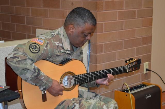 Staff Sgt. Jamie Cruz, Brooke Army Medical Center Warrior Transition Battalion entertains the audience Oct. 11, 2019 during a Hispanic Heritage celebration in the hospital's Medical Mall. The guest speaker for the event was Command Sgt. Maj. Alberto Delgado, command sergeant major, U.S. Army North, and the senior enlisted leader, Fort Sam Houston and Camp Bullis.