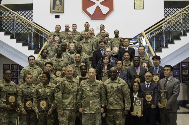 Eighth Army Maintenance and Supply Combined Logistics Excellence Awards winners and runners up pose for a photo with Eighth Army leadership at the Eighth Army headquarters building Oct. 16. (U.S. Army photo by Pfc. Ko, Bae Young)