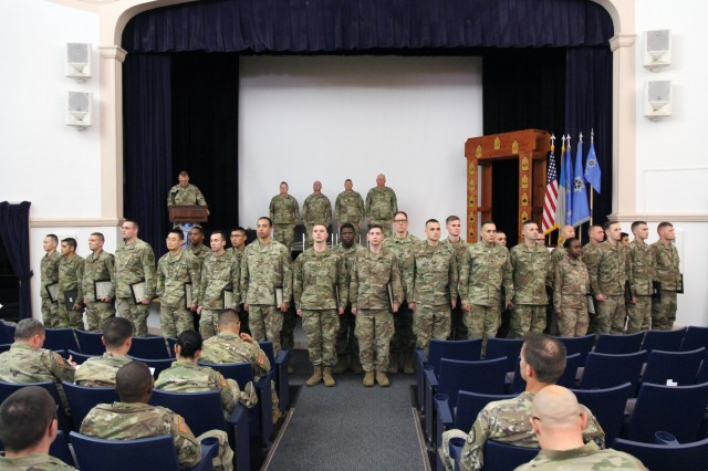 "FORT GEORGE G. MEADE, Md. - The 780th Military Intelligence Brigade (Cyber) hosted a Noncommissioned Officer (NCO) Induction ceremony for 27 NCOs at the Post Theater on October 16 in order to ""charge"" them with their increased duties and responsibilities as detailed in the Creed of the Army NCO and the NCO Charge."