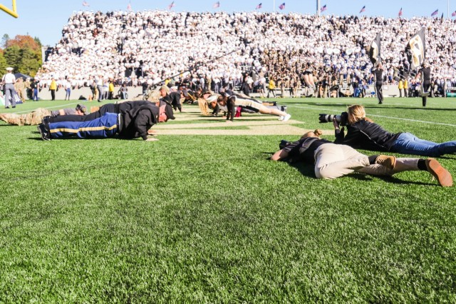 Class of 2023 Cadet Hannah Lamb (left) takes photos during the Army vs. Tulane game at Michie Stadium Oct. 5.  Lamb's job as a member of the Cadet Media Group is to capture the scenes of an Army home football game.