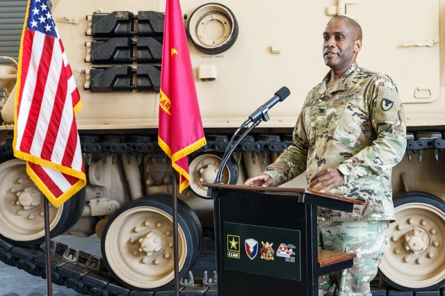 Anniston Army Depot Commander Col. Marvin Walker speaks Oct. 4 to employees gathered for the completion ceremony for M88A1 recovery vehicles overhauled for the Kingdom of Saudi Arabia.