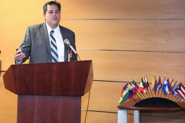 """Gustavo Menezes, a professor in the College of Engineering, Computer Science and Technology at California State University, Los Angeles, speaks to attendees at the Sept. 19 Hispanic Heritage Month Observance at the U.S. Army Corps of Engineers Los Angeles District headquarters building in downtown LA. The theme of the event was, """"Honoring Hispanic Americans: Essential to the Blueprint of the Nation."""" Menezes discussed the strategic plan to increase graduating rates for students in the College of ECST at the university. He also discussed the college's First Year Experience program for incoming freshman."""
