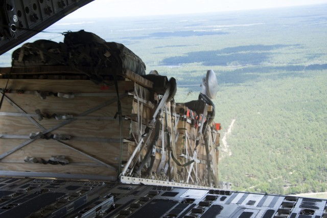 An Advanced Low Velocity Airdrop System -- Dual Row Airdrop System - ALVADS-DRAS - Mass Supply Load is airdropped using gravity release method during the Advanced Low Velocity Airdrop System -- Dual Row Airdrop System - ALVADS-DRAS - Follow-on Test and Evaluation (FOT&E) from a U.S. Air Force C-17 aircraft.