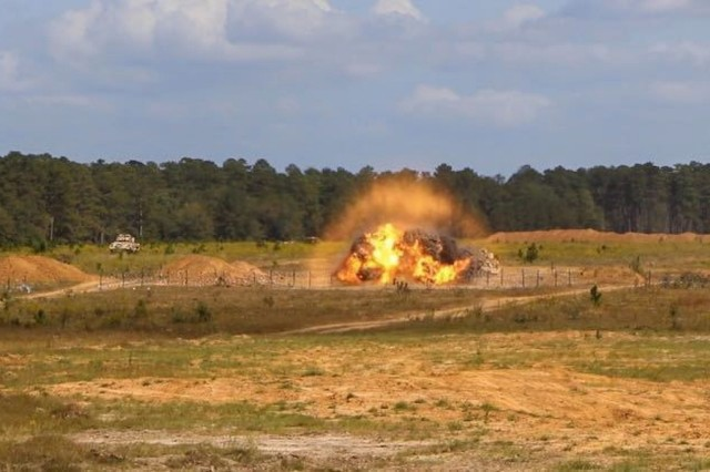 """Bangalores detonated to clear a wired obstacle during """"Gila Focus"""" by 9 BEB at Fort Stewart, Ga. Oct. 8, 2019.  Bangalores can be detonated manually with a detonator or a timed secondary fuse in case of failure manual detonation. (U.S. Army photo by Sgt. Trenton Lowery/released)"""