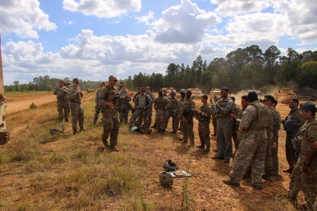 Capt. Christopher Kletzien conducting an After Action Report to the Soldiers of 9BEB and 2-69AR after completing the combined arms training exercise at Fort Stewart, Ga. Oct. 8, 2019.  The AAR allows the Soldiers to reiterate what they learned during the exercise and highlight areas and skills to improve on. (U.S. Army photo by Sgt. Trenton Lowery/released)