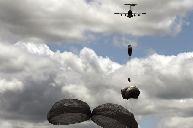A stick of Advanced Low Velocity Airdrop System -- Dual Row Airdrop System  - ALVADS-DRAS - loads are airdropped from a U.S. Air Force C-17 aircraft using gravity released method.