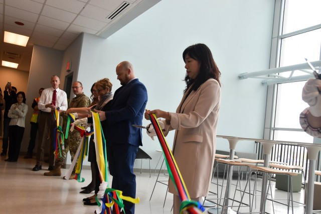 A ribbon cutting was held at the U.S. Army Corps of Engineers (USACE), Far East District (FED), headquarters to commemorate the completion of the district's USACE Leadership Development Program (ULDP) II cohort capstone project, Camp Humphreys, South Korea, Oct. 8, 2019. The goal of the group's capstone project was to bring FED together after the district relocated to Camp Humphreys last year and to provide a sense of community as well as offer a practical solution for meeting spaces for customers and visiting guests. A photo contest to hang pictures was recommended to the Corporate Board open to all FED employees and their family members capturing the area around Pyeongtaek and South Korea, focusing on nature and the elements of bodies of water, fields, trees/mountains/palaces, and skyline and to also be used as way finders for employees and guests as they first come to the building. The seating areas are to be used as work space or break space for small groups, individuals, and teams and as an ideal place to meet stakeholders during their visits. The team was well positioned with experts from contracting, architecture, and small contract purchasing and they poured their hearts into making this space happen. (Photos by Antwaun J. Parrish)