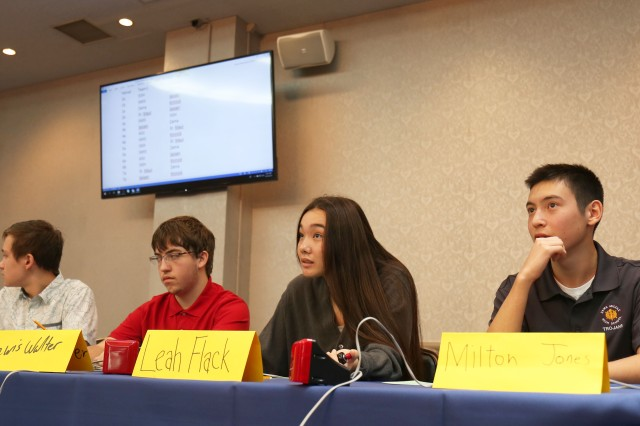 From left, Alexander Ala, Lewis Walter, Leah Sakamoto-Flack and Milton Jones, members of the Zama Middle High School team, listen to a question during the Brain Bowl, an academic quiz competition held Oct. 10 at the Camp Zama Community Club and featuring competitors from six other Department of Defense Dependents Schools and international schools in Japan.