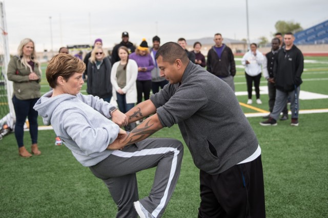 Erica Willis, Central Texas College self-defense instructor, teaches the crowd how to protect themselves against a threat.  Soldiers and leaders from Headquarters and Headquarters Company, 13th Expeditionary Sustainment Command, 1st Medical Brigade and community members, various units and organizations across Ft. Hood participated in a domestic violence awareness event at Fort Hood Stadium Oct. 17. (U.S. Army photos by Sgt. 1st Class Kelvin Ringold)