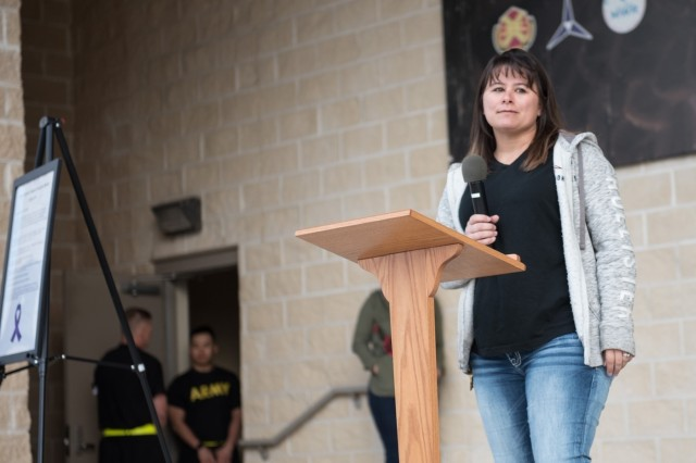 Spc. Kay Hosford, 1st Medical Brigade shares her experiences with domestic violence to those in attendance at Fort Hood Stadium Oct. 17.   Soldiers and leaders from Headquarters and Headquarters Company, 13th Expeditionary Sustainment Command, 1st Medical Brigade and community members, various units and organizations across Ft. Hood participated in a domestic violence awareness event at Fort Hood Stadium, and Hosford was the guest speaker. (U.S. Army photos by Sgt. 1st Class Kelvin Ringold)