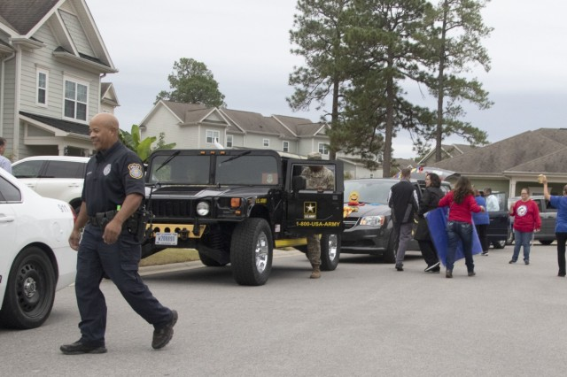 Math Prize Patrol participants pile into their caravan as they make their way through Fort Jackson Family housing Oct. 15. Students and parents filled out pledge forms promising to be a Family that solves math problems together to be entered into the drawing. The winners were not announced prior to the patrol appearing on their doorsteps. Families gathered on sidewalks to watch as the patrol honked horns and used noise makers to announce their arrival.