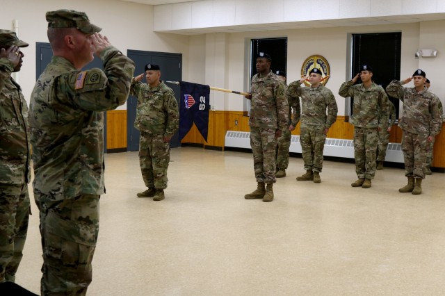 Soldiers from the 10th Mountain Division Sustainment Brigade, 10th Headquarters and Special Troops Battalion, 52nd Theater Gateway case their colors during a ceremony Oct. 17, 2019, in preparation for their upcoming deployment in support of Operation Inherent Resolve (OIR), Operation Spartan Shield (OSS), and Operation Freedom Sentinel (OFS).
