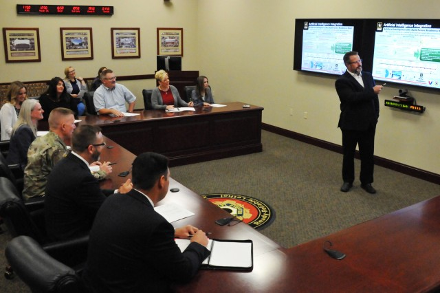 Steve Taylor, Deputy Chief of Staff for Information Management, briefs Joint Munitions Command staff members on potential opportunities for incorporating Artificial Intelligence technologies to streamline future munitions processes.