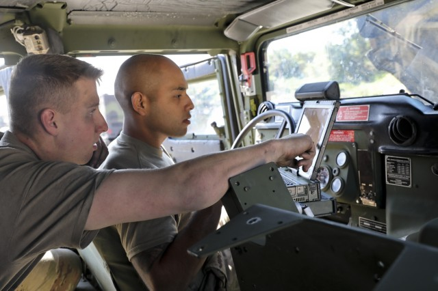 U.S. Army Pvt. Brent Dehollander and Spc. Marcos Martinez both of 6-9 Cavalry Regiment, 3rd Armored Brigade Combat Team, 1st Cavalry Division, work together to diagnose a problem on a High Mobility Medium-Wheeled Vehicle at Rodriguez Live Fire Range, Republic of Korea, Oct. 8, 2019. 3rd ABCT, 1st Cav. Div. from Fort Hood, Texas is currently on rotation to the R.O.K. (U.S. Army Photo by Staff Sgt. Jacob Kohrs, 20th PAD)