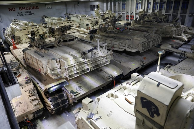 Over 300 pieces of equipment to include M1A1 Abrams tanks and Bradley Fighting Vehicles await downloading from the Green Ridge Roll-on Roll-off cargo vessel Oct. 16, 2019 in Riga, Latvia. 1st Battalion 9th Cavalry Regiment is set to train with partner and Allies in Lithuania during Atlantic Resolve.(U.S. Army photo by Sgt. Benjamin Northcutt, 21st Theater Sustainment Command)