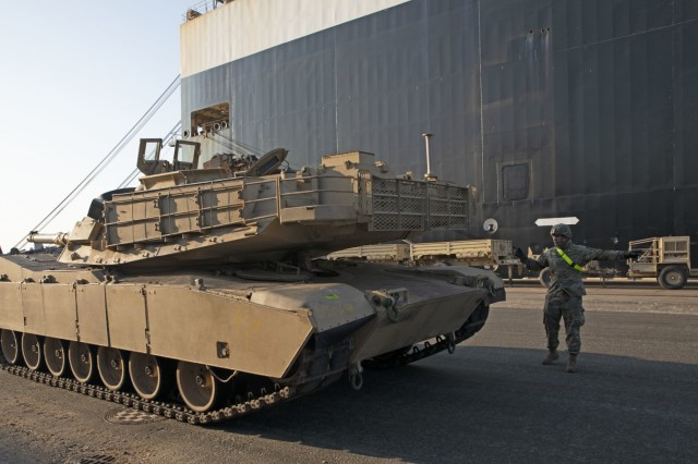 A U.S. Army Soldier ground guides an M1 Abrams after it was offloaded from the Green Ridge, a carrier vessel, at Port of Riga, Latvia, Oct. 16, 2019. Over 300 of pieces of equipment arrived at the Port of Riga in support of units moving in to the European theater for Atlantic Resolve, an ongoing series of bilateral exercises designed to enhance the working relationship and capabilities between the U.S. and partners and NATO allies. (U.S. Army photo by Sgt. Erica Earl, 5th Mobile Public Affairs Detachment)