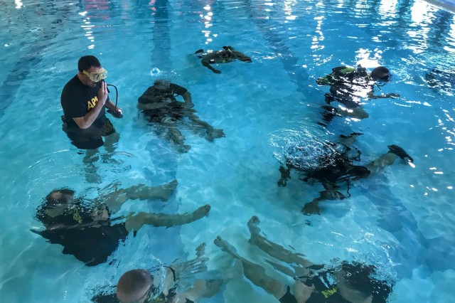 U.S. Soldiers with the 28th Expeditionary Combat Aviation Brigade conduct water survival training during an exercise at the pool at Somerset Area High School, October 19, 2019.