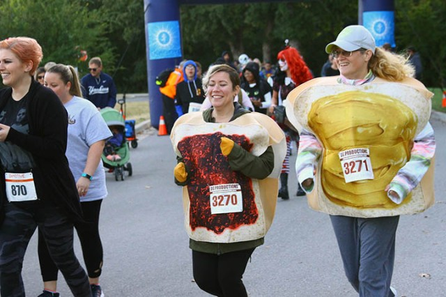 Stefanie Brannan (No. 870), Carrie Jones (jelly), and Heather Barnes (peanut butter) run in the 5K Monster Dash Oct. 19, 2019, at Fort Sill, Oklahoma. About 200 people participated in the inaugural competitive run.