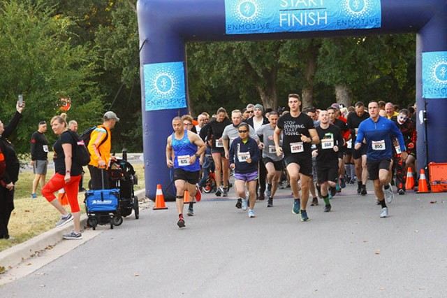 Runners, joggers, and walkers take off at the 5K Monster Dash Oct. 19, 2019, at the Fort Sill Youth Center.