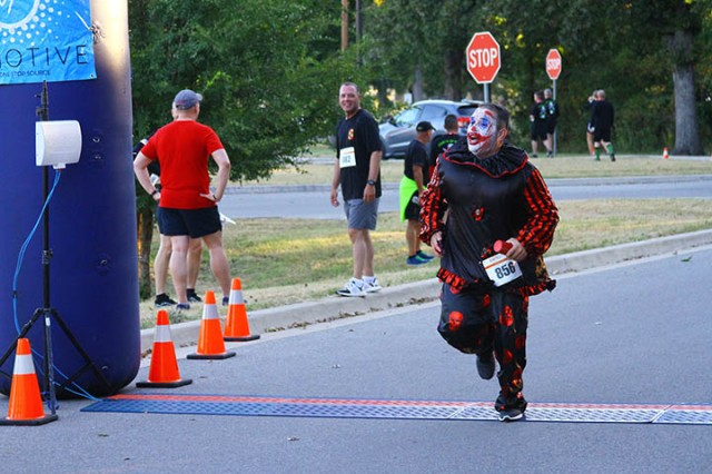 Juan Chacon dressed as The Joker crosses the finish line. He highly recommended the current movie.
