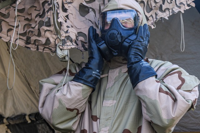 A Soldier assigned to the 101st Airborne Division (Air Assault) clears his Chemical, Biological, Radiological, Nuclear protective mask during Warfighter Exercise 20-01 on Fort Campbell, Kentucky, Sept. 30. The exercise was a two-week multi-echelon exercise designed to challenge participants by combining realistic training conditions and a virtual battlefield environment. (U.S. Army photo by Pfc. John Simpson, 40th Public Affairs Detachment)