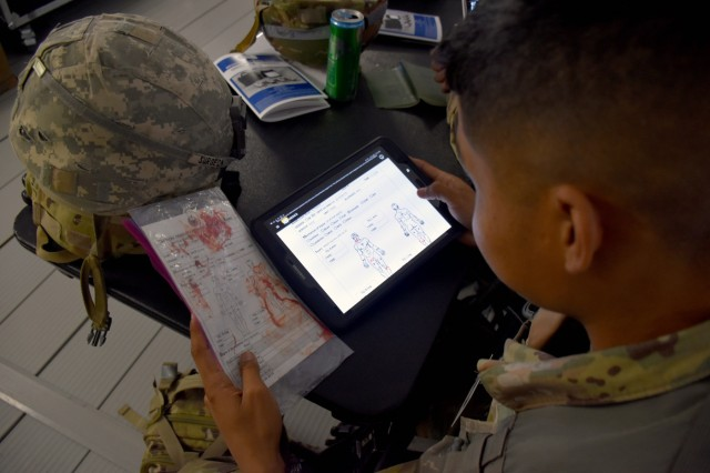 With MEDHUB, medics can use a tablet to complete a Tactical Combat Casualty Care Card electronically. At the receiving hospital, clinicians can see the data for incoming patients and ensure that they have proper staff and equipment on hand for treatment. (Photo by Ashley Force, USAMMDA Public Affairs)