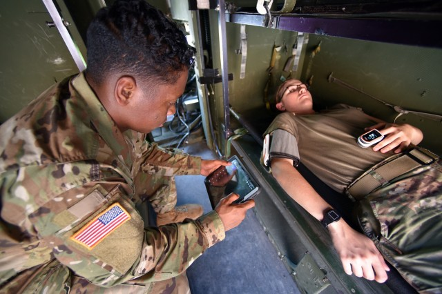 Soldiers with the 44th Medical Brigade put the MEDHUB device through its paces at Fort Bragg, North Carolina. MEDHUB uses wearable sensors, accelerometers and other technology to improve communication among patients, medics and receiving field hospitals. (Photo by U.S. Army Medical Materiel Agency)
