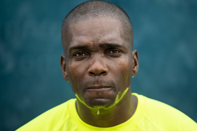 Lt. Col. Frederick Moss, a senior staff officer for the U.S. Army Reserve Headquarters at Fort Bragg, North Carolina, stares into the camera for a portrait at the North Carolina Veterans Park in Fayetteville, North Carolina, Sept. 27, 2019. Moss runs multiple military races each year - including the Army Ten Miler in Washington, D.C. - while carrying a binder holding the names of the fallen Vietnam War service members. Moss decided to print the binder and run with it in honor of his father, Terry Leon Williams, who is a Vietnam veteran who survived the war, but who lost comrades in combat. Moss recognized that his father's generation of veterans were rarely welcomed with open arms after they returned from war. His desire to run with the binder is an effort to bring remembrance to their legacy.