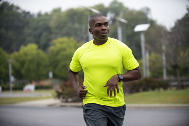 Lt. Col. Frederick Moss, a senior staff officer for the U.S. Army Reserve Headquarters at Fort Bragg, North Carolina, runs nearby the North Carolina Veterans Park in Fayetteville during a film production Sept. 27, 2019. Moss runs multiple military races each year - including the Army Ten Miler in Washington, D.C. - while carrying a binder holding the names of the fallen Vietnam War service members. Moss decided to print the binder and run with it in honor of his father, Terry Leon Williams, who is a Vietnam veteran who survived the war, but who lost comrades in combat. Moss recognized that his father's generation of veterans were rarely welcomed with open arms after they returned from war. His desire to run with the binder is an effort to bring remembrance to their legacy.