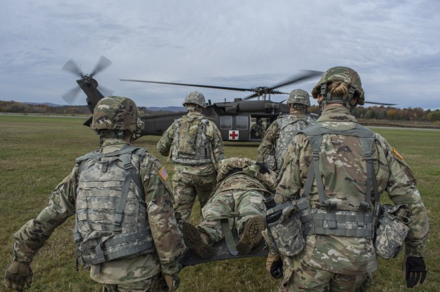 New York National Guard Soldiers of the 466th Area Support Medical Company conduct medical evacuation training with medevac aircrews of C Company, 1st Battalion, 171st General Support Aviation, at Floyd Bennet Memorial Airport in Queensbury, New York, Oct. 20th, 2019. The training prepares the medics of the 466th for mobilization and deployment to Iraq in 2020.