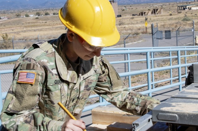 Army Reserve Spc. Shaylene Quigley, a carpentry and masonry specialist with the 333rd Engineer Detachment (Utilities), prepares to cut lumber for an engineering project at an Army Reserve Center in Santa Fe, New Mexico, October 19, 2019. (Army photo by Staff Sgt. David Overson)
