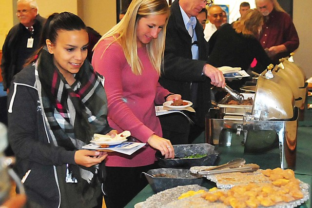 Attendees sample a variety of food offered as part of the Hispanic Heritage Month observance Oct. 17 in Heritage Hall at Rock Island Arsenal. (Photo by Jon Micheal Connor, ASC Public Affairs)