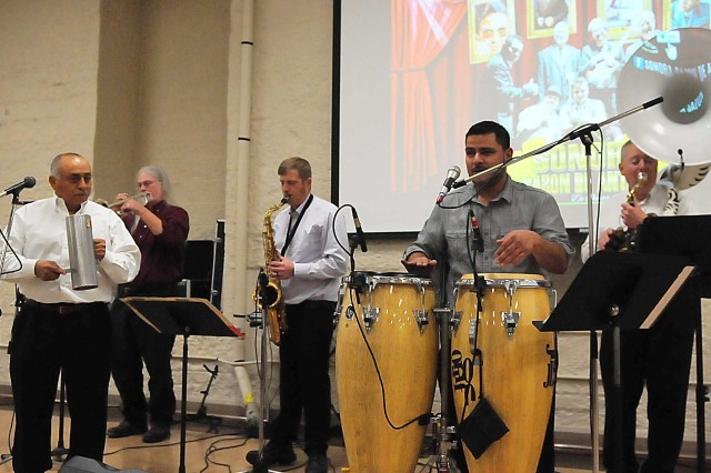 The Sonora Sozon De Antano Band, led by musical director Omar Alaniz (second from right), performs during the Rock Island Arsenal Hispanic Heritage Month observance Oct. 17. (Photo by Jon Micheal Connor, ASC Public Affairs)