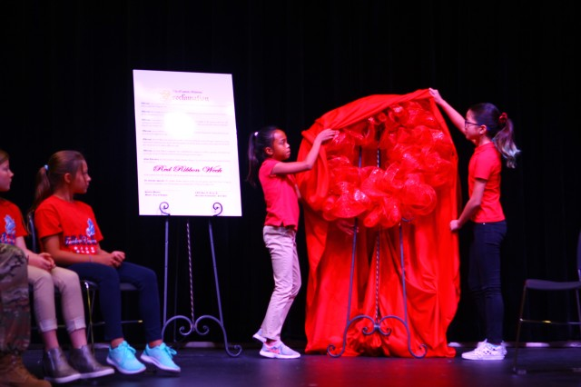 Students unveil the Red Ribbon Week wreath during kick off ceremonies Oct. 22, 2019, at Freedom Elementary School. It was the 38th Annual Red Ribbon campaign at Fort Sill.