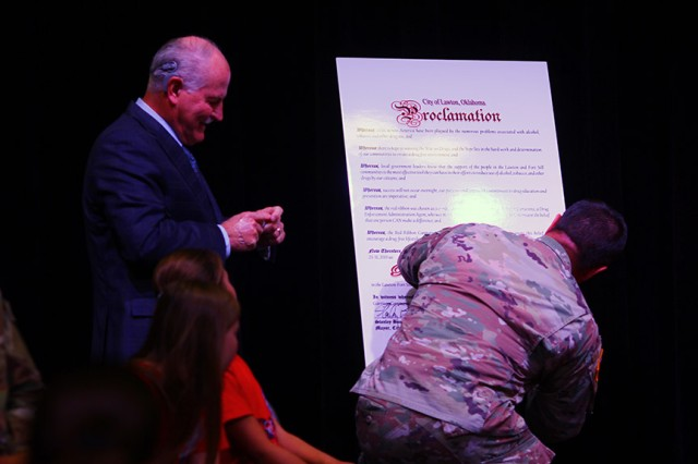 Lawton Mayor Stan Booker and Fort Sill Garrison Commander Col. Don King sign the City of Lawton Red Ribbon Week proclamation Oct. 22, 2019, at Freedom Elementary School.