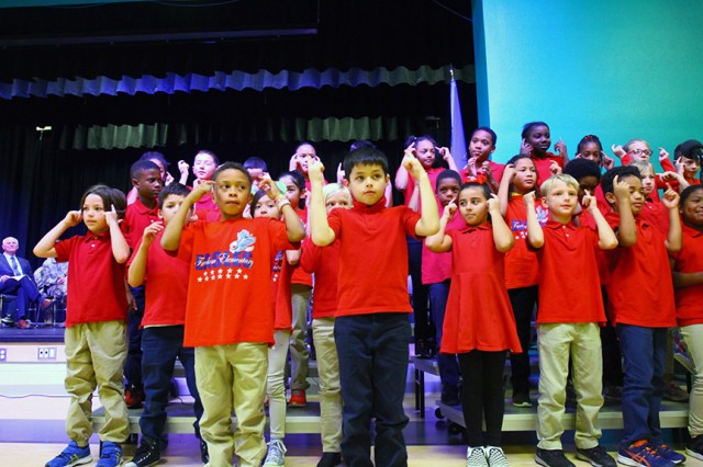 Third-graders from Freedom Elementary School gesture they have clear heads because they are drug free as they sing during the Red Ribbon Week kick off Oct. 22, 2019, at their school.