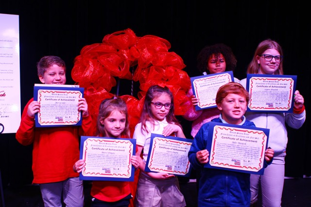 Students who won the poster, and essay contests hold their certificates of appreciation after the Red Ribbon Week kick off ceremony Oct. 22, 2019.