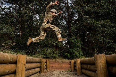 A Soldier leaps over an obstacle during the Army Best Medic Competition at Joint Base Lewis-McChord, Wash., Sept. 24, 2019. Twenty-eight two-Soldier teams from all around the world traveled to Washington state to compete in the finals to be named the...